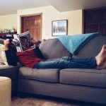 man lounging on the couch